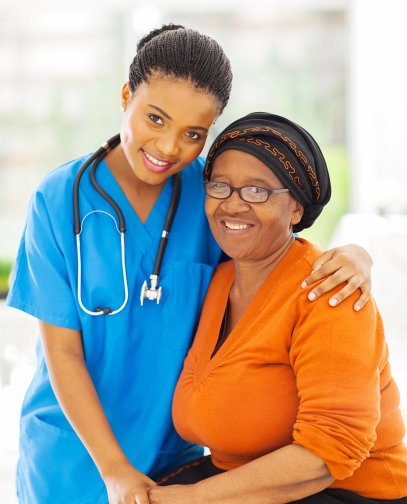 caregiver with stethoscope hugging her patient