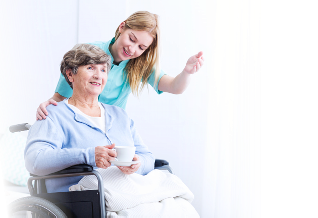 old woman in a wheelchair assisted by her caregiver