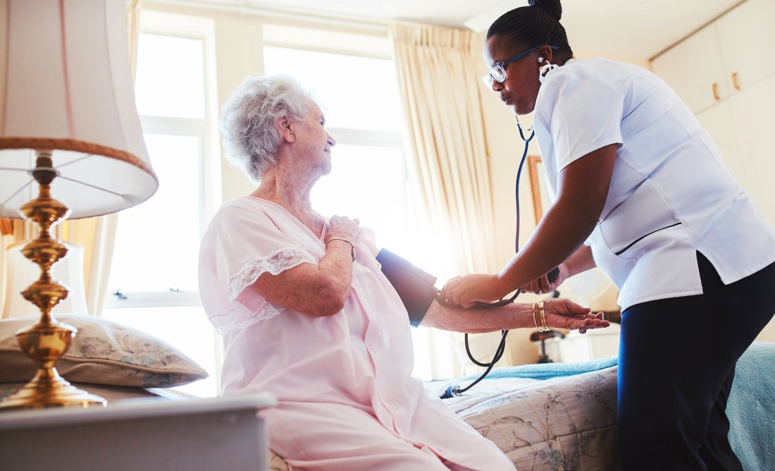 elderly woman having her blood pressure checked