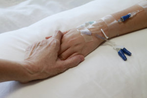 caregiver holding the patient's hand