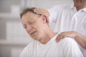 elderly man having physical therapy