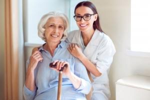 senior woman with her kind nurse